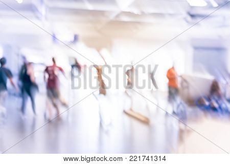 Blurred Customers Waiting To Return Or Exchange Furniture On Forklift