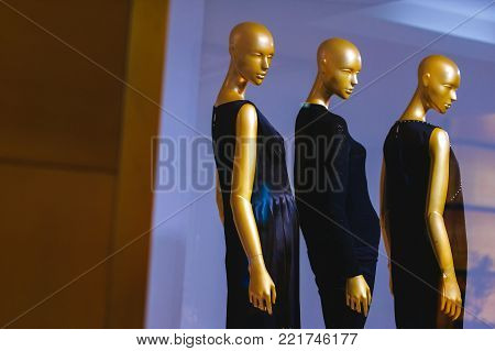 Golden mannequin in the form of a sexy woman. Golden mannequins