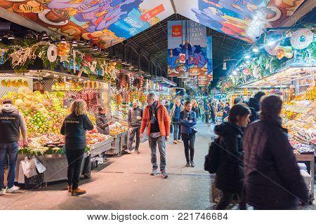 Barcelona, Spain 12.14.2017 editorial shot of market stalls and people at Mercat de la Boqueria