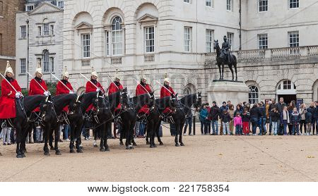 London, United Kingdom - October 29, 2017: Mounted guards outside Horse Guards off Whitehall in London. Tourists watch the ceremony