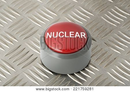 Red circular push button labeled 'nuclear' on aluminum diamond plate background