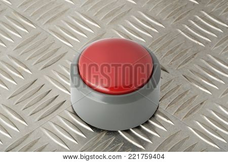 Red circular push button on a steel diamond plate background