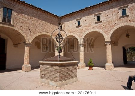 Italian courtyard, with centrepiece well.