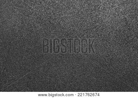 Grey texture. Macro shoot of non-stick surface of frying pan. Horizontal color photography.