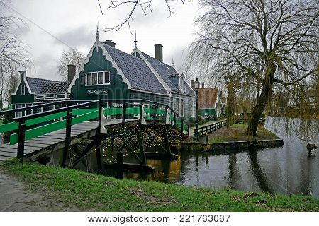 Zaanse Schans, Netherlands - December 31, 2017: Zaanse Schans is a neighbourhood of Zaandam, near Zaandijk, Netherlands. The Zaanse Schans is one of the popular tourist attractions of the Netherlands.