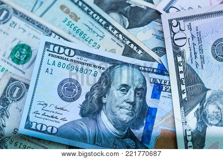 close up of USA banknotes, 100 us dollar note, 50 us dollar notes, 20 us dollar notes.