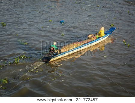 Mekong Delta, Vietnam - Feb 2, 2016. Motorboat running at Nga Nam floating market in Mekong Delta, Vietnam. Nga Nam is one of many famous floating markets in the south of Vietnam.