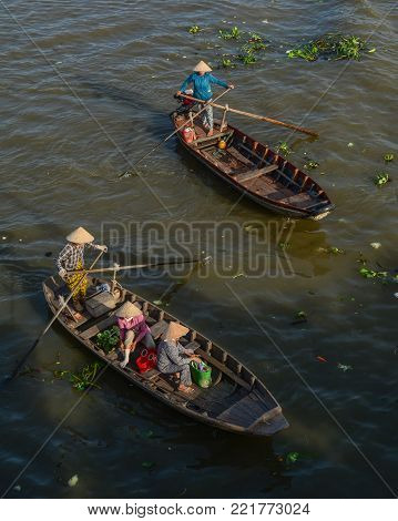 Soc Trang, Vietnam - Feb 2, 2016. Women rowing boats on Mekong River in Soc Trang, South of Vietnam. Mekong is the world 12th-longest river and the 7th-longest in Asia.