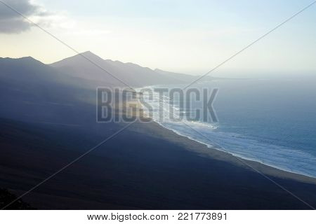 Breathtaking view on famous beach Cofete on the Canary Island Fuerteventura, Spain. The beach is empty and is tweve km long, tucked away behind the mountains.