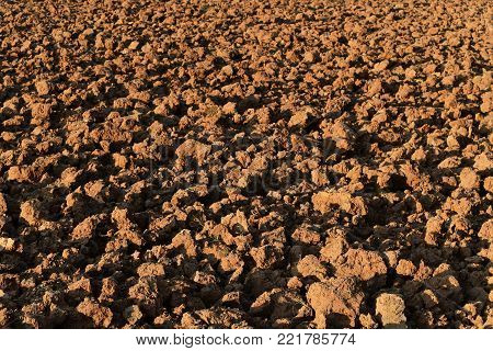 soil lump in rice field before plant rice for brown background