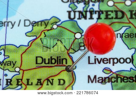 Close-up of a red pushpin on a map of Dublin, Ireland.