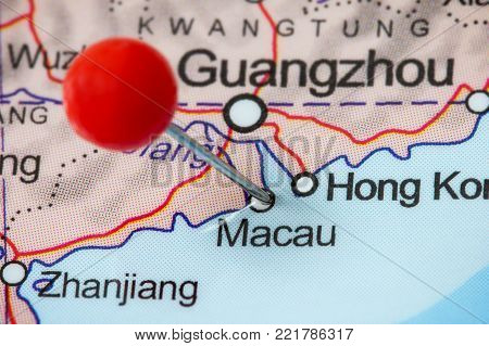 Close-up of a red pushpin in a map of Macau (Macao), China.