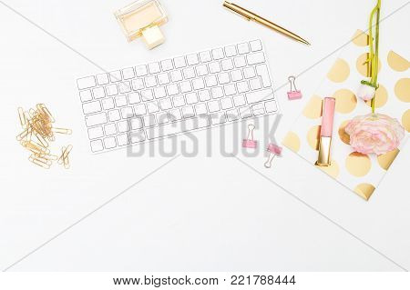 Styled feminine desk and beaty. Copy space