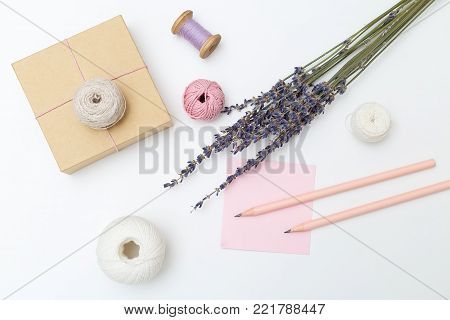 Bouquet of lavender and gift box on a white background. Flat lay