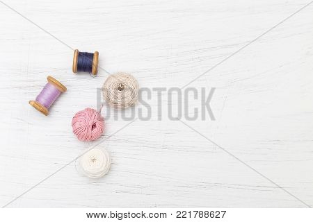 Spool of thread on wooden background. Product mockup