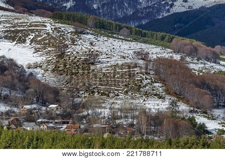 Majestic view of cloudy sky, winter mountain, snowy glade, residential district, conifer and deciduous forest   from Plana mountain toward Vitosha mountain, Bulgaria, Europe