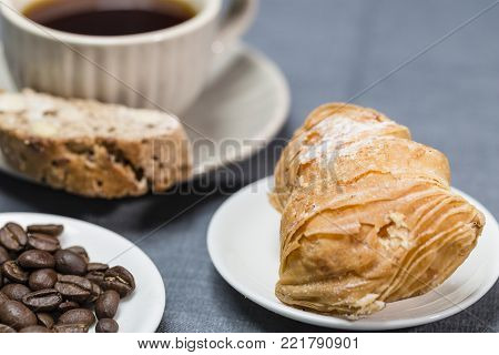 Sicilian puff pastry with coffee cup and coffee beans