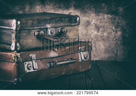 Vintage leather suitcases. Processing in vintage style. The concept of travel.