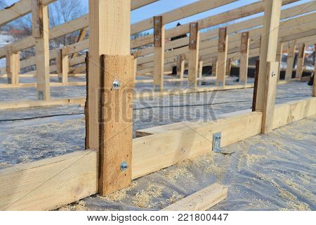 Wooden roofing construction frame, new roof skeleton, binding parts closeup.