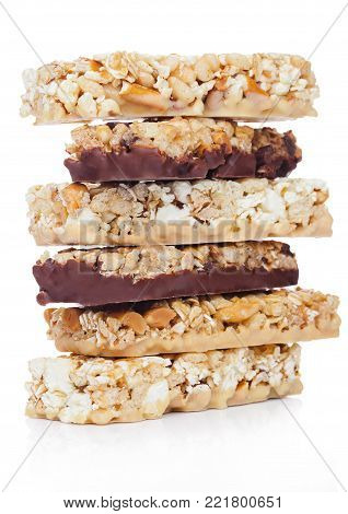 Protein cereal energy bars with nuts and caramel and chocolate for breakfast on white background