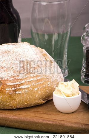Sourdough Bread. Traditional Irish bread made from wheat and buttermilk with a bottle of Irish Stout.