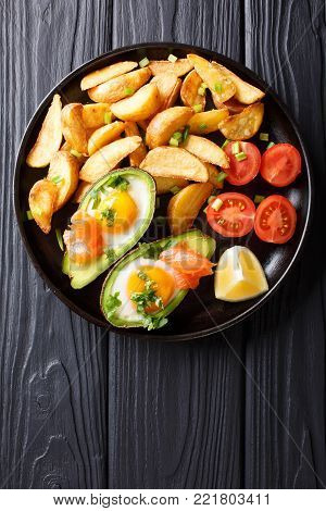 Delicious Food: Baked Avocado Stuffed With Eggs And Salmon, Fresh Tomatoes And Potato Close-up. Hori