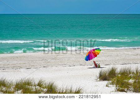 Beach Umbrella and Chair on the White Sand Beach of Anna Maria Island, Florida