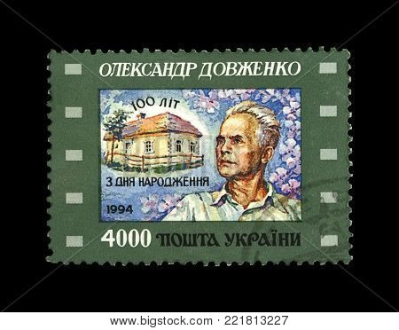 UKRAINE - CIRCA 1994: canceled stamp printed in Ukraine shows famous ukrainian film producer Alexander Dovzhenko, 100th birth anniversary, circa 1994. vintage post stamp isolated on black background.