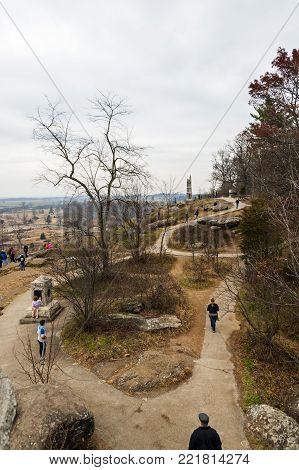 Gettysburg, USA - November 25, 2016: People explore site of the Gettysburg battlefield.
