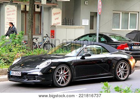 Berlin, Germany - September 12, 2013: Motor car Porsche 911 (991) in the city street.