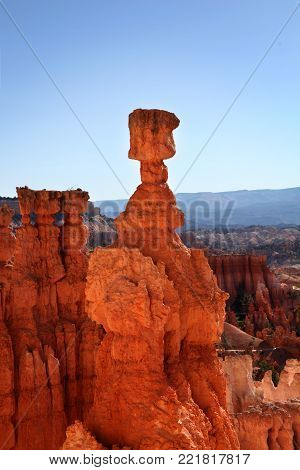 Thor's Hammer hoodoo silhouetted against the blue sky in Bryce Canyon National Park