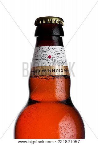 LONDON, UK - JANUARY 10, 2018: Cold Bottle of Wainwright golden beer on white .background