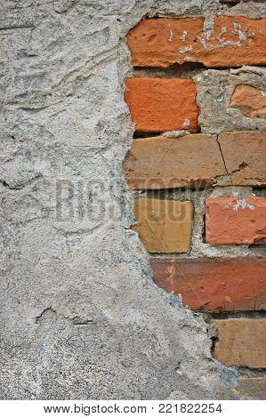 Red bricks stone wall background closeup, cracked ruined stucco, vertical plastered grunge grey beige stonewall limestone pattern, old aged weathered gray lime plaster texture, natural grungy textured reddish vintage, rough rustic brick birckwork