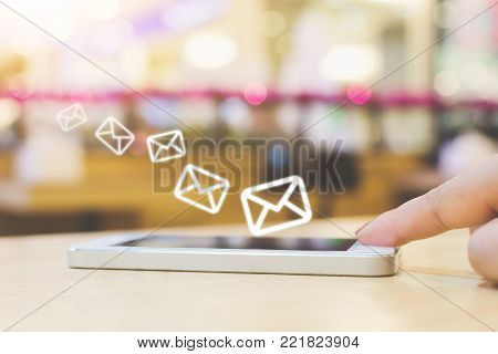 Woman hand using mobile phone with e-mail application, Concept email marketing and newsletter