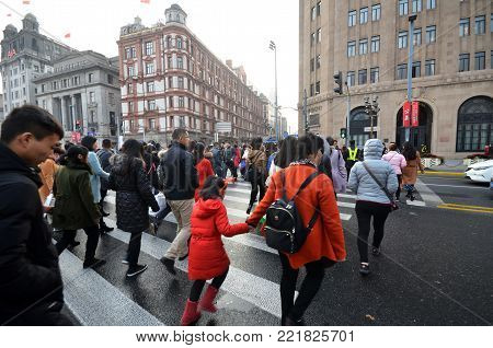 Commuters In A Busy Crosswalk At The Bund In Shanghai, China