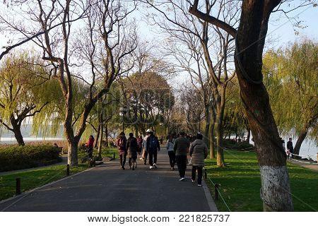 People Walk Around The Beautiful Scenic Area In West Lake In Hangzhou, China.