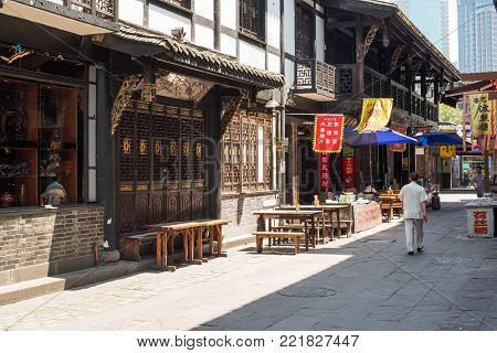 Chengdu, China - June 3, 2016 : People walking in an old traditional chinese street near Wenshu monastery