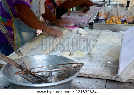 Thai People Cooking Deep-fried Doughstick Or Youtiao