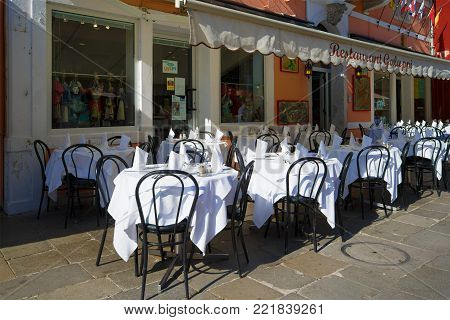 VENICE, ITALY - SEPTEMBER 26, 2017: Italian restaurant in anticipation of visitors. Burano Island