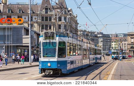 Zurich, Switzerland - 3 June, 2015: a tram passing along Bahnhofbrucke bridge. Trams make an important contribution to public transport in Zurich, they have been a consistent part of the cityscape since the 1880s, electrified from the 1890s.