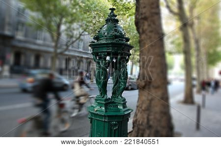 The famous Wallace fountain (1872) on the streets of Paris, France. Tilt shift lens.