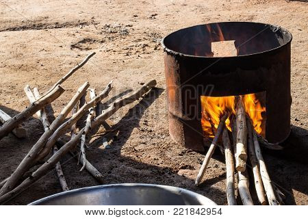 Stove firewood made of gallon tank for cooking.