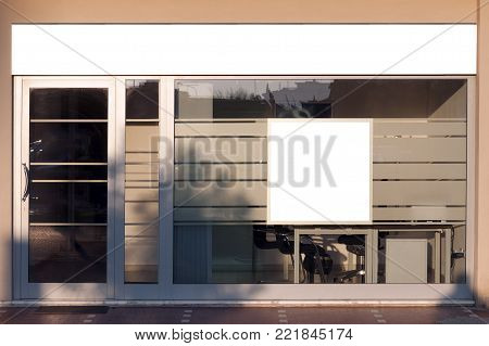 A store front with blank spaces for signboard and advertising