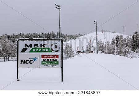 UMEA, SWEDEN ON DECEMBER 11. View of a sign, information board on December 11, 2017 in Umea, Sweden. Newly-fallen snow and overcast weather. Editorial use.