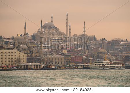 ISTANBUL, TURKEY - JANUARY 09, 2015: View of the Suleiman Mosque from the Golden Horn Bay on a January cloudy evening