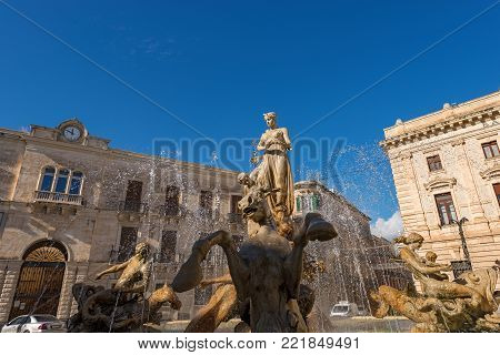 Close-up of the fountain of Diana, Archimedes square (1907 by Giulio Moschetti) in downtown of Ortigia, Syracuse, Sicily island, Italy