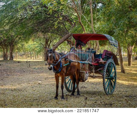 Bagan, Myanmar - Feb 18, 2016. Horse cart waiting at ancient Buddhist temple in Bagan, Myanmar. Bagan in central Burma is one of the world greatest archeological sites.