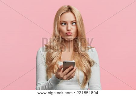 Beautiful Woman With Makeup And Long Blonde Hair Blows Kiss, Demonstrates Her Good Feelings, Says Go