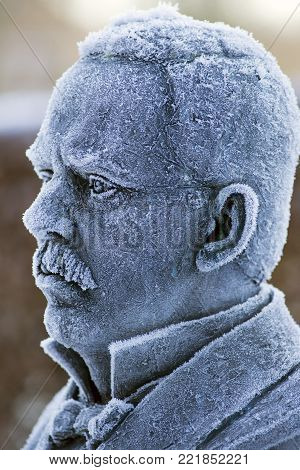 RIBE, DENMARK  -JANUARY 7 2018: Bust with hoarfrost of the world's famous Danish photographer and journalist, Jaob A (1849 - 1914). Riis. Born in Ribe and later emigrated to America. The bust performed by artist Gudrun Steen-Andersen and placed in Ribe, D