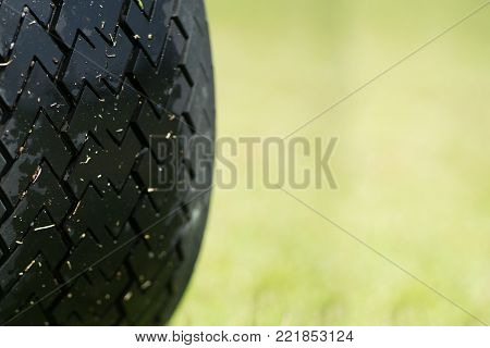 Close up wheel of Buggy car in a golf course.
